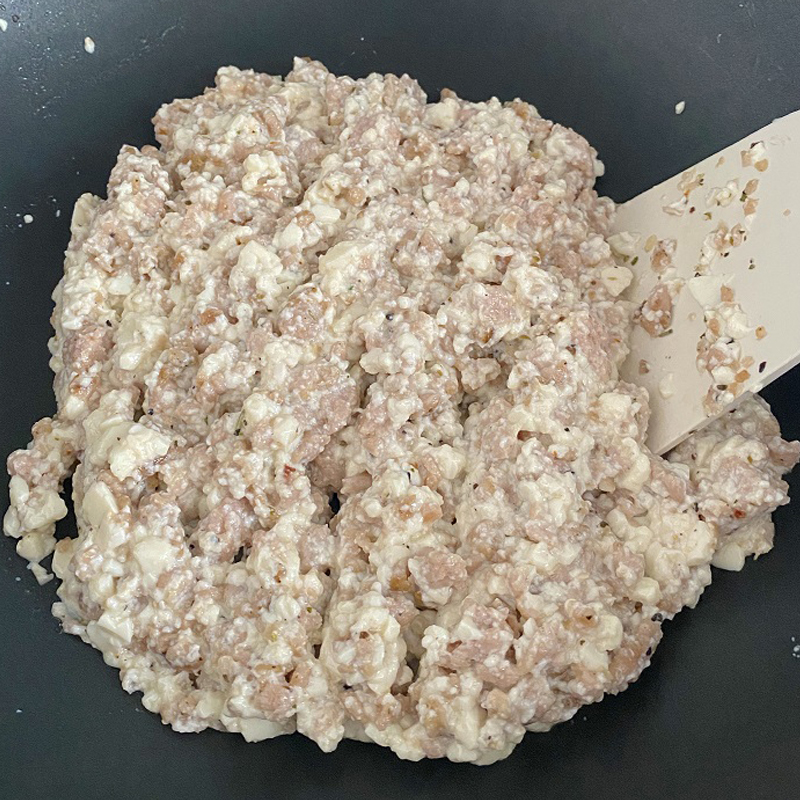 Switch off the gas and add tofu. Mix until tofu and SoMeat become paste like.