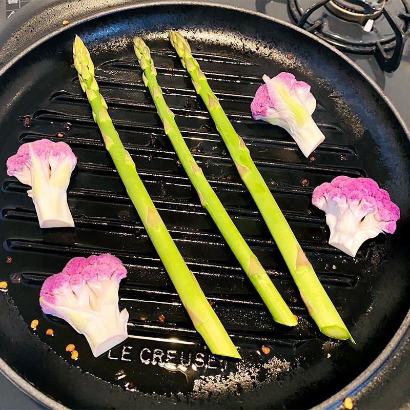 Grill asparagus and cauliflower halves.