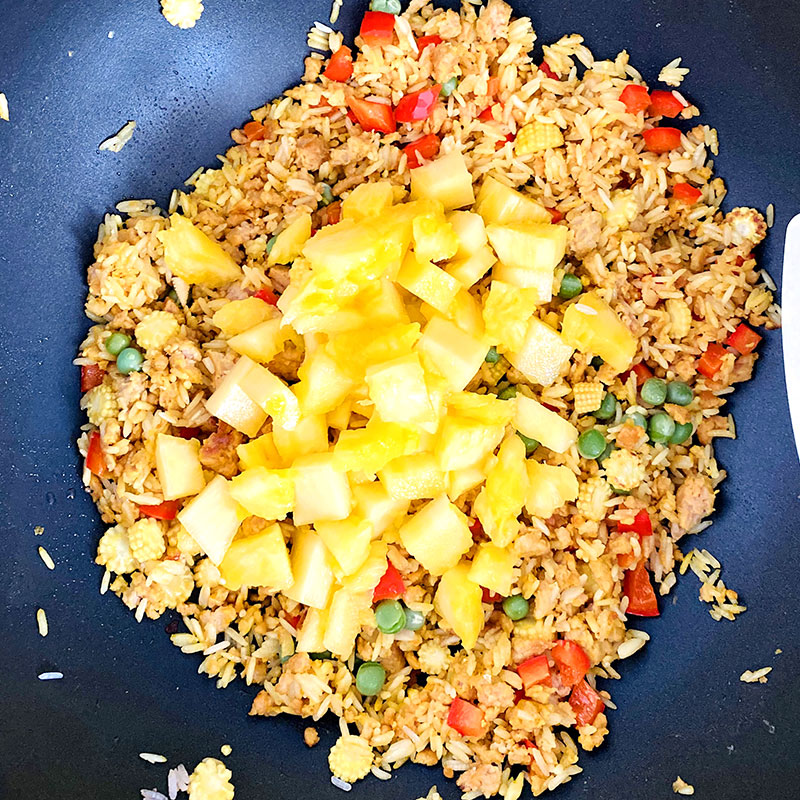 Add the pineapple squares to rice and SoMeat. And mix.