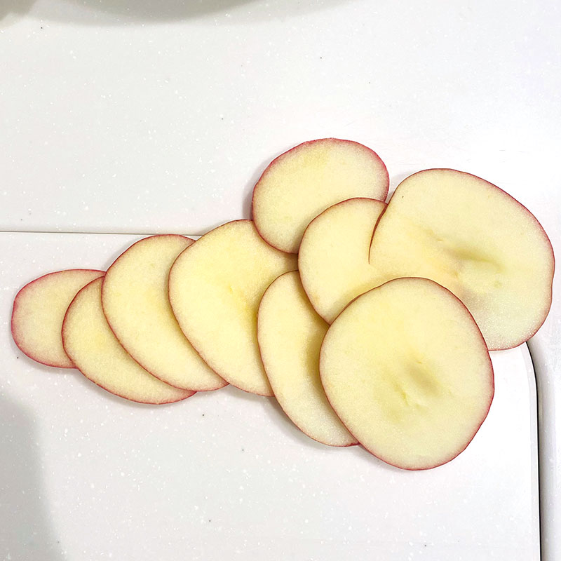 Wash and slice the apple.