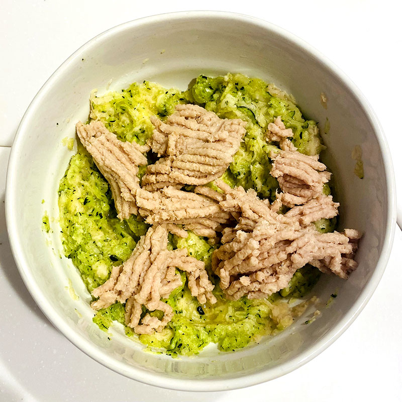 Add the SoMeat to the bowl with the grated potatoes and zucchini. Then mix them.